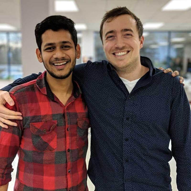 Closeup of two men smiling