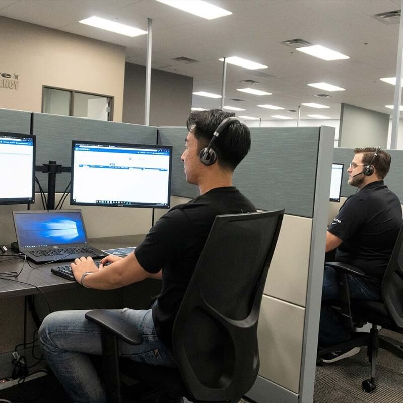 A Geotab office with employees working at their cubicles